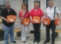 Members of the Loughmore/Castleiney Defibrillator Group in Tipperary Receiving five AEDs
